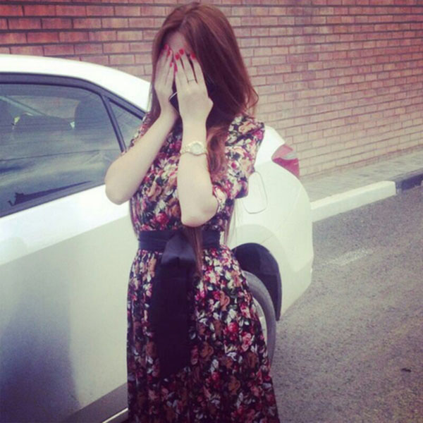 Girl with car hiding face with hands