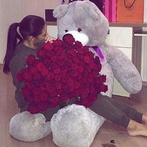 girl-with-teddy-bear-and-red-roses